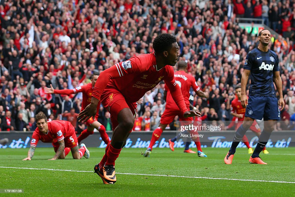 Daniel Sturridge of Liverpool celebrates scoring the opening goal during the Barclays Premier League match between Liverpool and Manchester United at Anfield on September 01, 2013 in Liverpool, England.