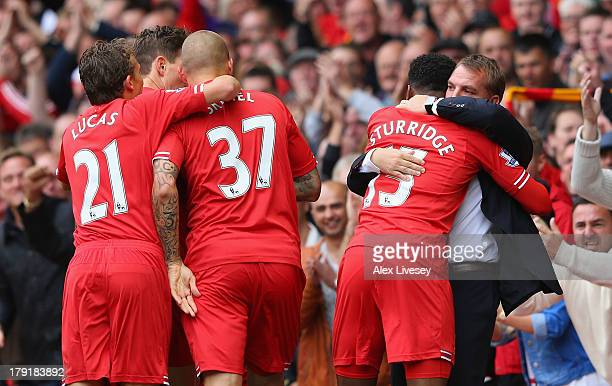 Daniel Sturridge of Liverpool celebrates scoring the opening goal with Manager Brendan Rodgers during the Barclays Premier League match between...