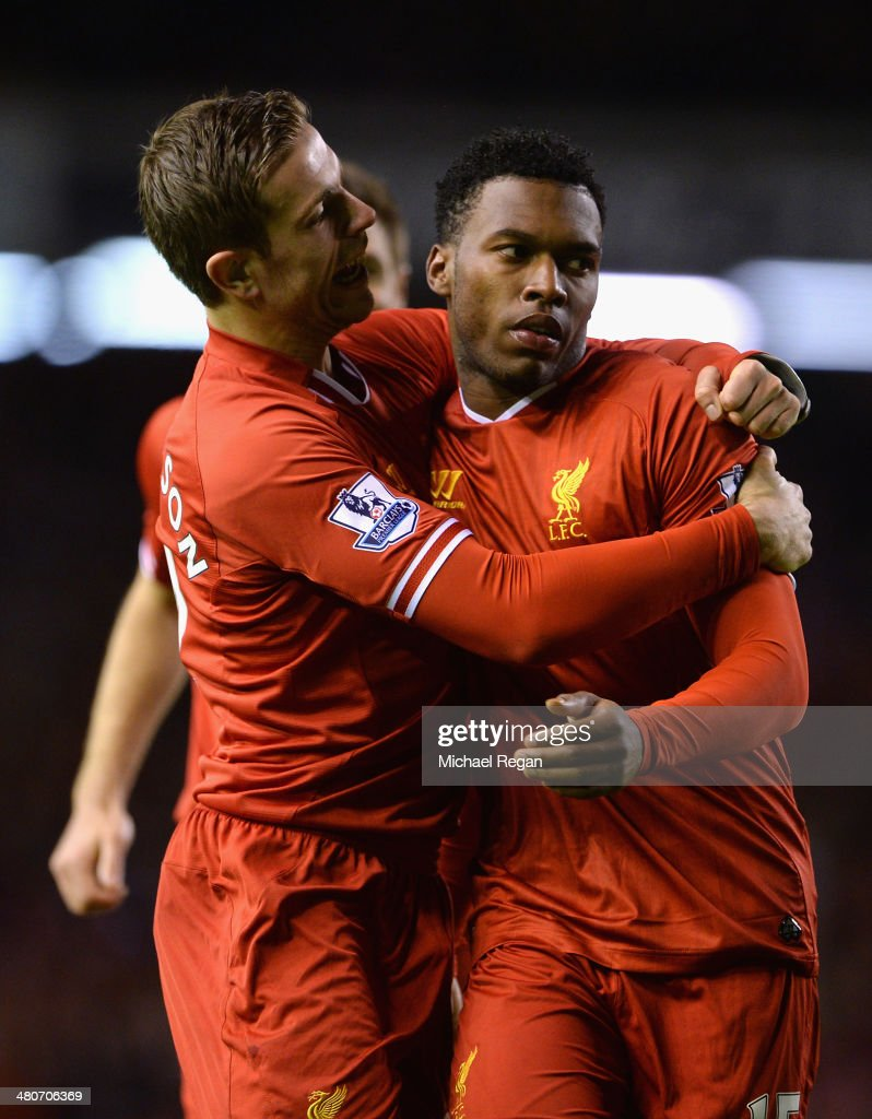 Daniel Sturridge of Liverpool celebrates scoring the second goal with team-mate Jordan Henderson (l) during the Barclays Premier League match between Liverpool and Sunderland at Anfield on March 26, 2014 in Liverpool, England.