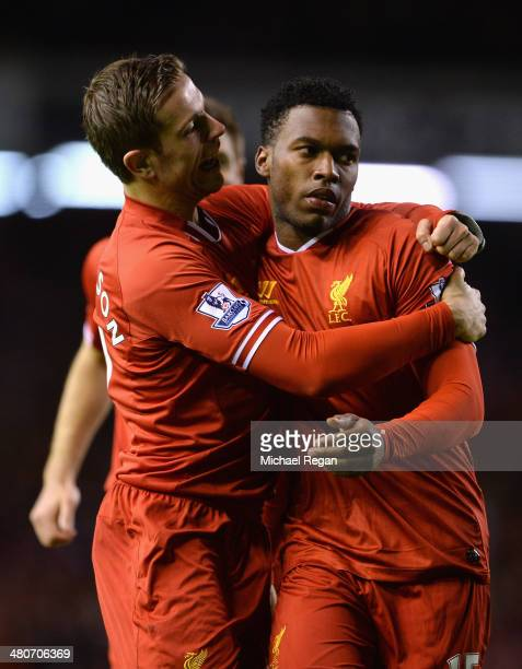 Daniel Sturridge of Liverpool celebrates scoring the second goal with teammate Jordan Henderson during the Barclays Premier League match between...