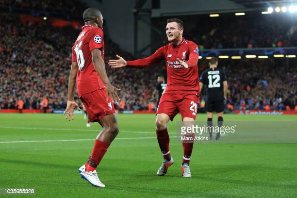 Daniel Sturridge of Liverpool celebrates scoring their 1at goal with Andrew Robertson during the Group C match of the UEFA Champions League between...