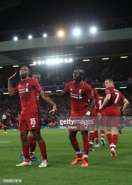 Daniel Sturridge of Liverpool celebrates scoring their 1st goal with team mates during the Group C match of the UEFA Champions League between...