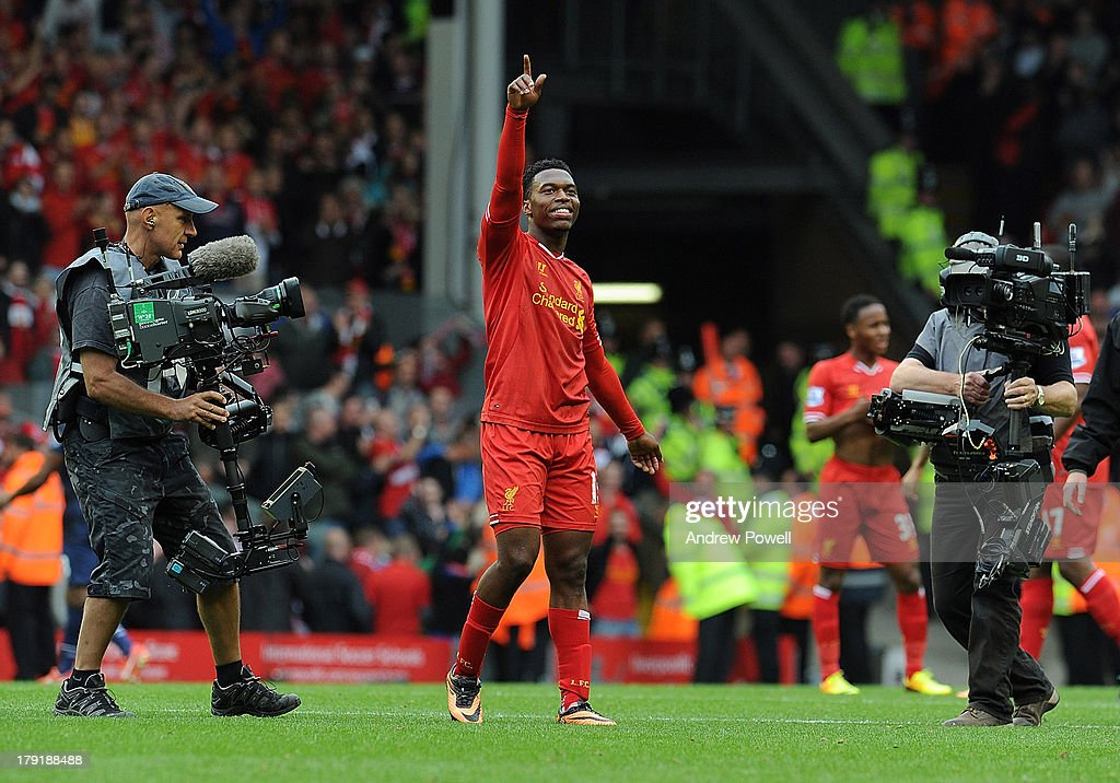 Daniel Sturridge of Liverpool celebrates the win at the end of the Barclays Premier League match between Liverpool and Manchester United at Anfield on September 01, 2013 in Liverpool, England.