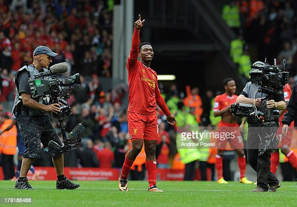 Daniel Sturridge of Liverpool celebrates the win at the end of the Barclays Premier League match between Liverpool and Manchester United at Anfield...