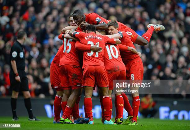 Daniel Sturridge of Liverpool celebrates with his teammates after scoring the fourth goal during the Barclays Premier League match between Liverpool...