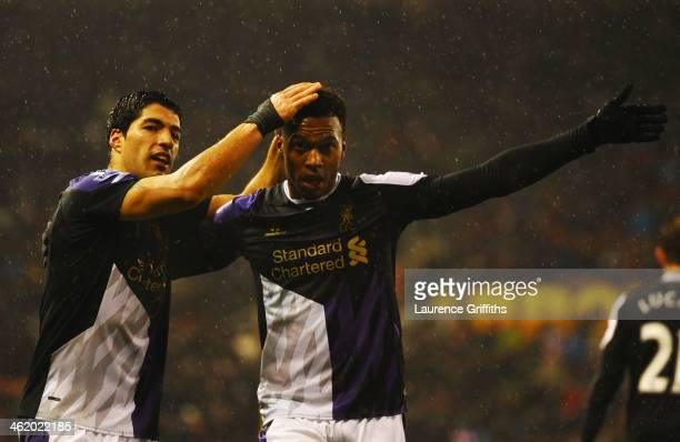 Daniel Sturridge of Liverpool celebrates with Luis Suarez as he scores their fifth goal during the Barclays Premier League match between Stoke City...