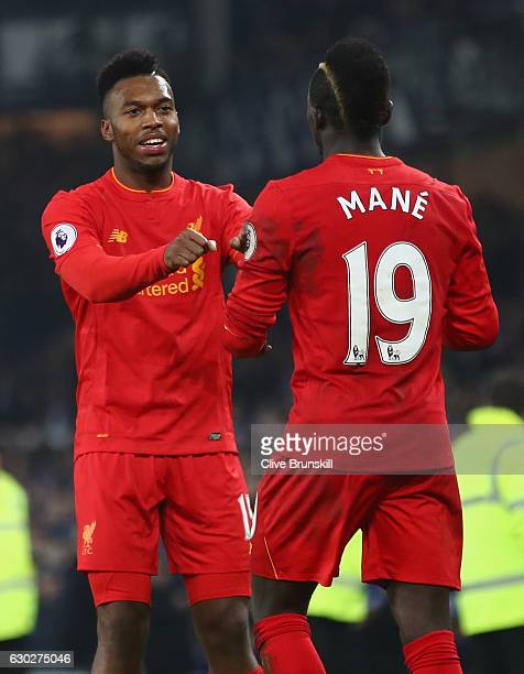 Daniel Sturridge of Liverpool celebrates with team mate and goal scorer Sadio Mane after his injury time winnerduring the Premier League match...