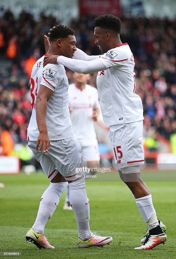 Daniel Sturridge of Liverpool celebrates with team mate Jordan Ibe after scoring his team's second goal of the game during the Barclays Premier League match between A.F.C. Bournemouth and Liverpool at the Vitality Stadium on April 17, 2016 in Bournemouth, England.