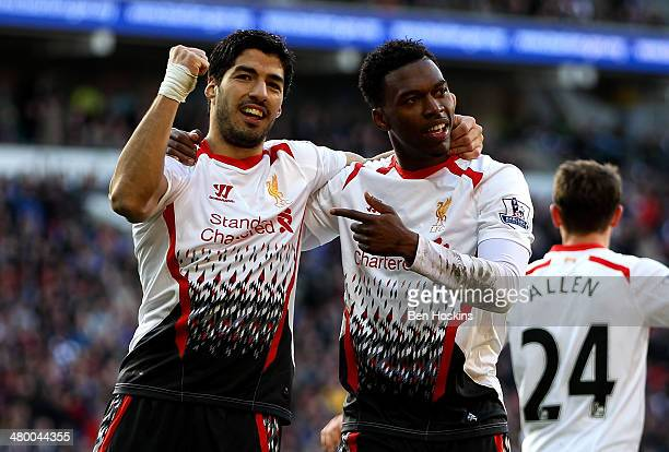 Daniel Sturridge of Liverpool celebrates with team mate Luis Suarez after scoring his team's fifth goal during the Barclays Premier League match...