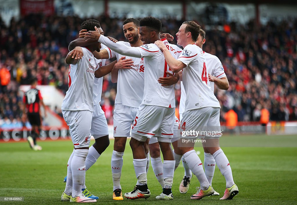Daniel Sturridge of Liverpool celebrates with team mates after scoring his team's second goal of the game during the Barclays Premier League match between A.F.C. Bournemouth and Liverpool at the Vitality Stadium on April 17, 2016 in Bournemouth, England.