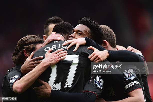 Daniel Sturridge of Liverpool celebrates with team mates as he scores their second goal during the Barclays Premier League match between Southampton...