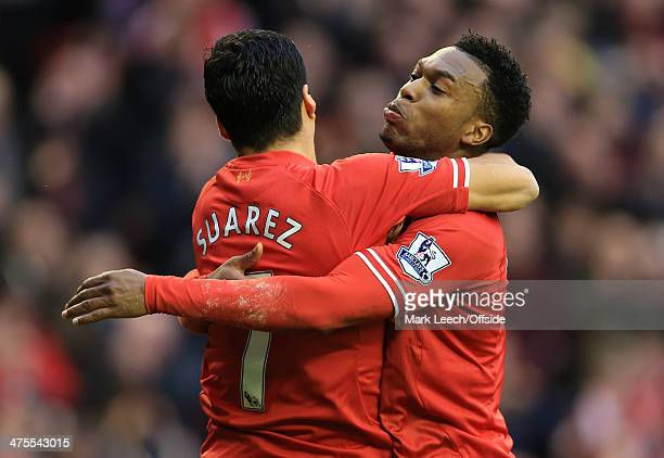 Daniel Sturridge of Liverpool celebrates with teammate Luis Suarez after scoring their 3rd goal during the Barclays Premier League match between...
