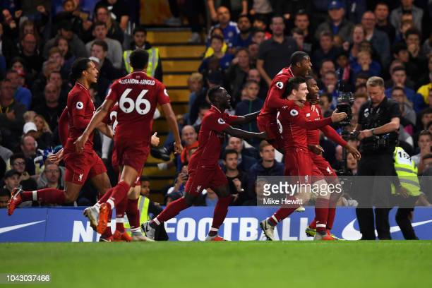 Daniel Sturridge of Liverpool celebrates with teammates after scoring the equalising goal during the Premier League match between Chelsea FC and...