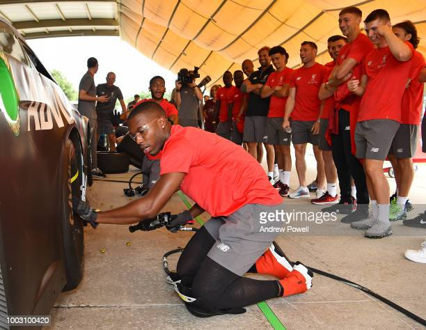 Daniel Sturridge of Liverpool changing tyres during a tour of Roush Fenway Racing on July 21 2018 in Charlotte North Carolina