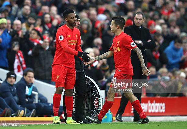 Daniel Sturridge of Liverpool comes on for Philippe Coutinho of Liverpool during the Premier League match between Liverpool and Swansea City at...