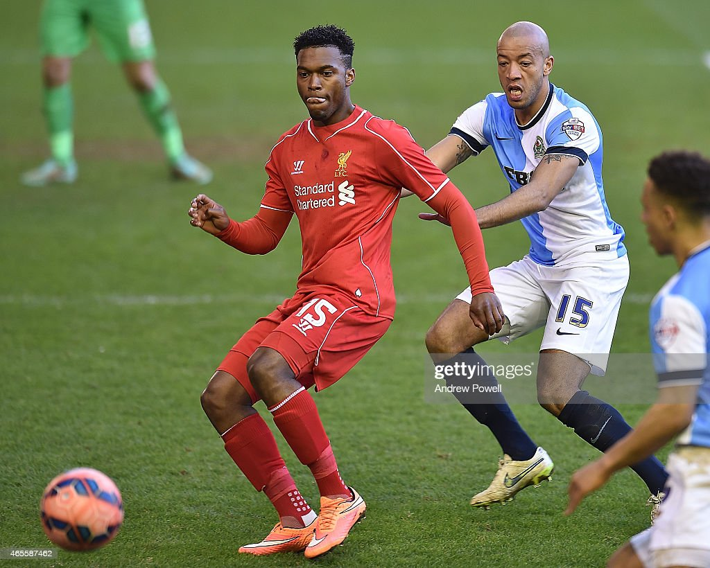 Daniel Sturridge of Liverpool competes with Alex Baptiste of Blackburn Rovers during the FA Cup Quarter Final match between Liverpool and Blackburn Rovers at Anfield on March 8, 2015 in Liverpool, England.