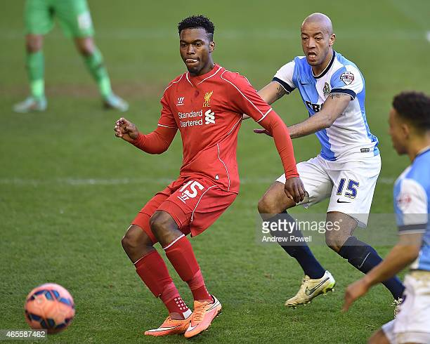 Daniel Sturridge of Liverpool competes with Alex Baptiste of Blackburn Rovers during the FA Cup Quarter Final match between Liverpool and Blackburn...