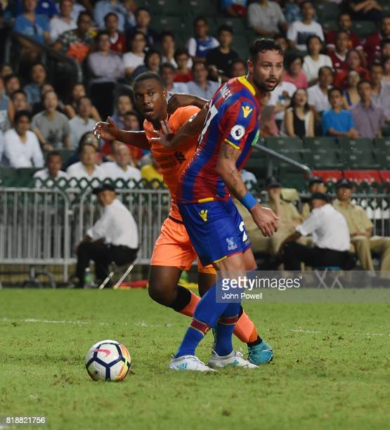 Daniel Sturridge of Liverpool competes with Damien Delaney of Crystal Palace during the Premier League Asia Trophy match between Liverpool FC and...