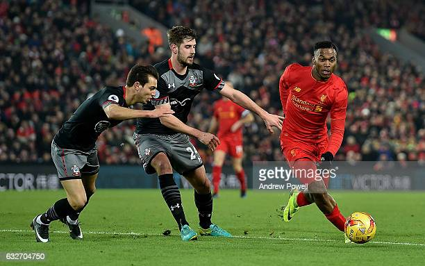 Daniel Sturridge of Liverpool competes with Jack Stephens of Southampton during the EFL Cup SemiFinal second leg match between Liverpool and...