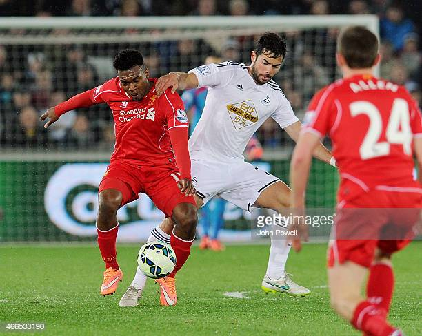 Daniel Sturridge of Liverpool competes with Jordi Amat of Swansea City during the Barclays Premier League match between Swansea City and Liverpool at...