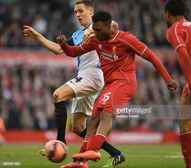 Daniel Sturridge of Liverpool competes with Matthew Kilgallon of Blackburn Rovers during the FA Cup Quarter Final match between Liverpool and...
