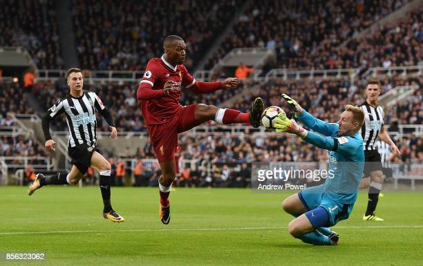 Daniel Sturridge of Liverpool competes with Rob Elliot of Newcastle United during the Premier League match between Newcastle United and Liverpool at...