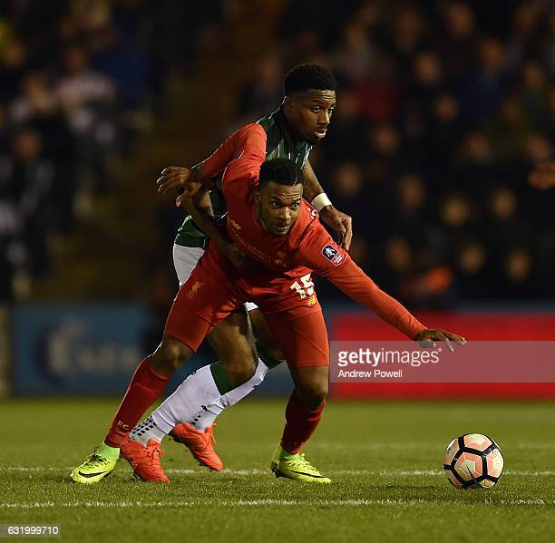 Daniel Sturridge of Liverpool competes with Yann Songo'o of Plymouth Argyle during the Emirates FA Cup Third Round replay match between Plymouth...