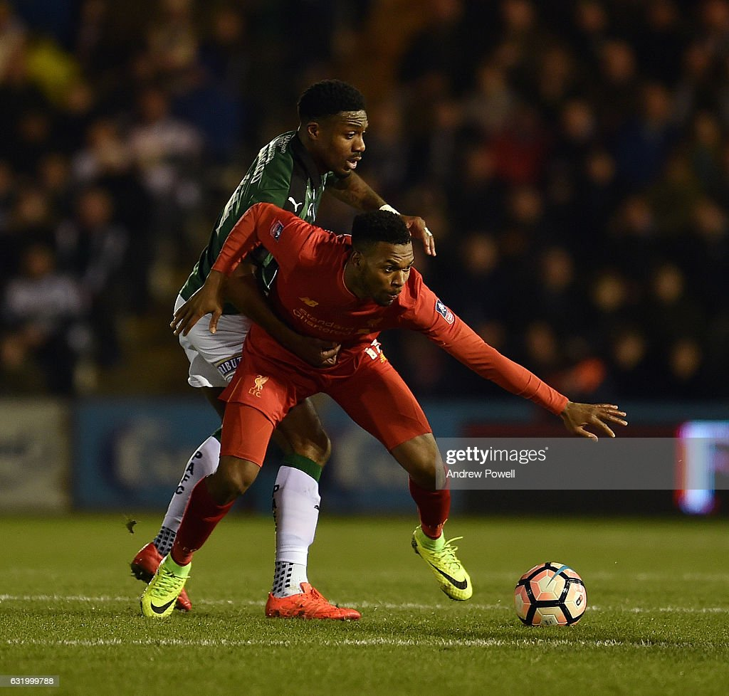 Daniel Sturridge of Liverpool competes with Yann Songo'o of Plymouth Argyle during the Emirates FA Cup Third Round replay match between Plymouth Argyle and Liverpool at Home Park on January 18, 2017 in Plymouth, England.