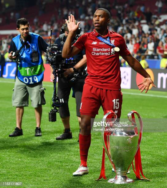 Daniel Sturridge of Liverpool dances with the trophy during the UEFA Champions League Final between Tottenham Hotspur and Liverpool at Estadio Wanda...