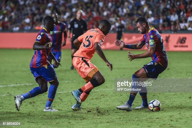 Daniel Sturridge of Liverpool FC competes for the ball against Damien Delany of Crystal Palace during a 2017 Premier League Asia Trophy fixture at...