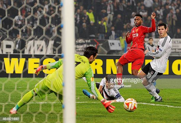 Daniel Sturridge of Liverpool forces Cenk Gonen of Besiktas JK to make a save during the UEFA Europa League Round of 32 match between Besiktas JK and...