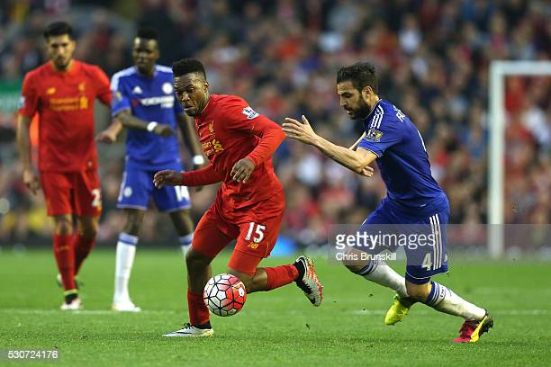 Daniel Sturridge of Liverpool goes past Cesc Fabregas of Chelsea during the Barclays Premier League match between Liverpool and Chelsea at Anfield on...