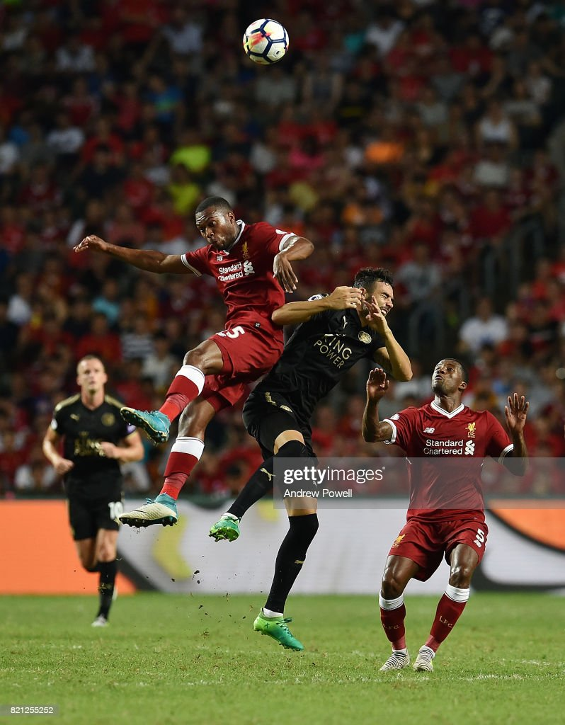 Daniel Sturridge of Liverpool goes up with Vicente Iborra of Leicester City during the Premier League Asia Trophy match between Liverpool FC and Leicester City FC at the Hong Kong Stadium on July 22, 2017 in Hong Kong, Hong Kong.