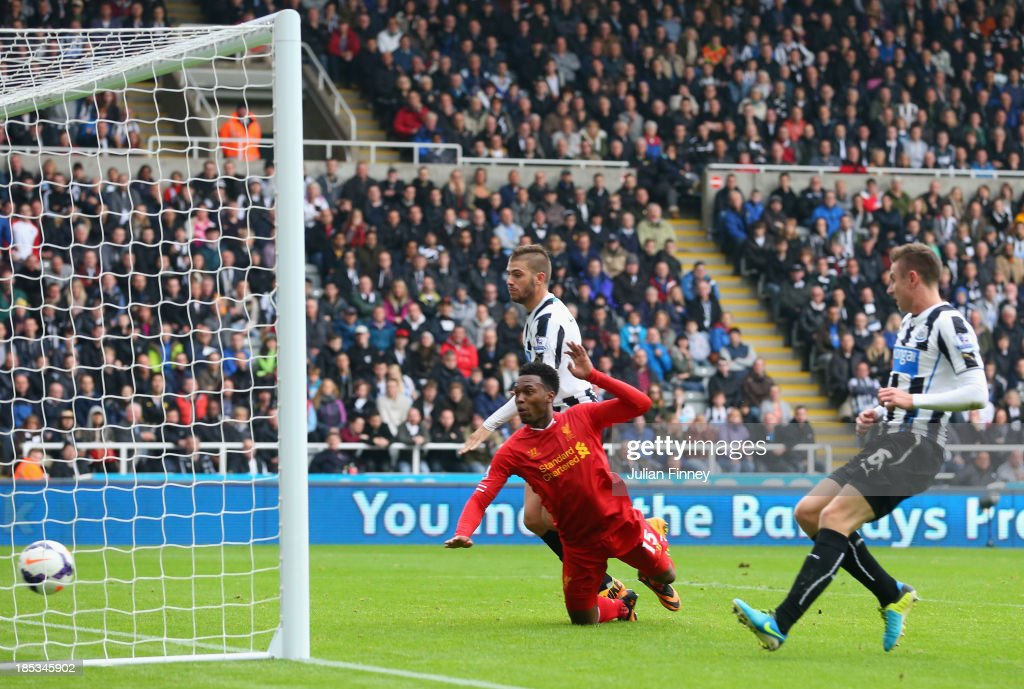 Daniel Sturridge of Liverpool heads in their second goal during the Barclays Premier League match between Newcastle United and Liverpool at St James' Park on October 19, 2013 in Newcastle upon Tyne, England.
