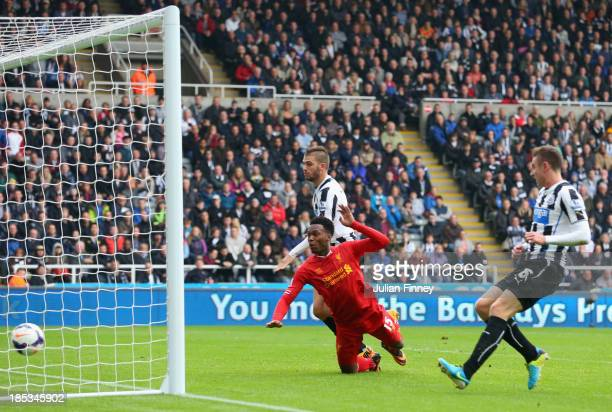 Daniel Sturridge of Liverpool heads in their second goal during the Barclays Premier League match between Newcastle United and Liverpool at St James'...