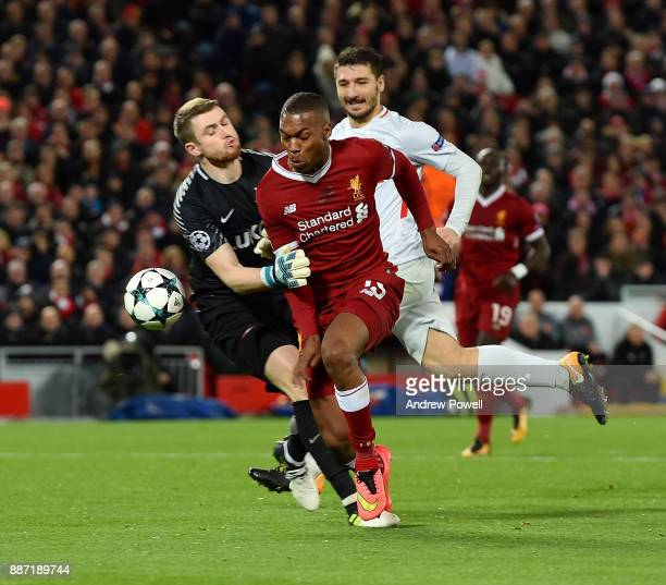 Daniel Sturridge of Liverpool is brought down by Artyom Rebrov of Spartak Moskva during the UEFA Champions League group E match between Liverpool FC...