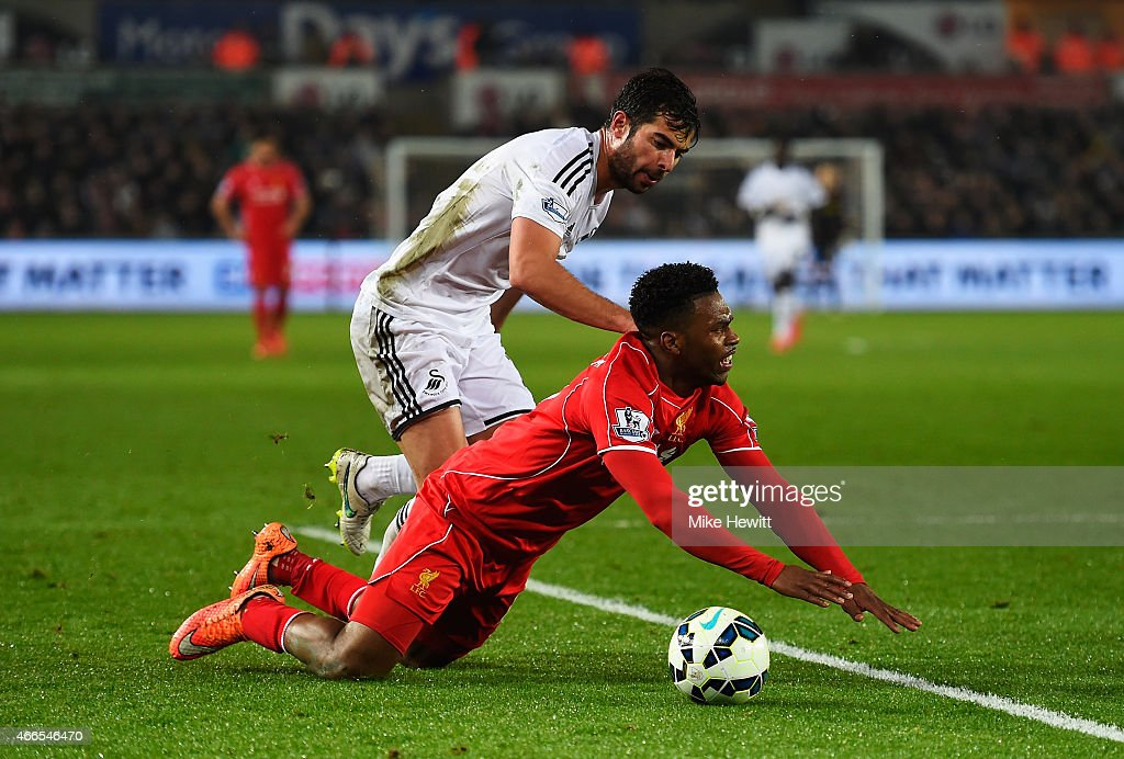 Daniel Sturridge of Liverpool is fouled by Jordi Amat of Swansea City during the Barclays Premier League match between Swansea City and Liverpool at Liberty Stadium on March 16, 2015 in Swansea, Wales.