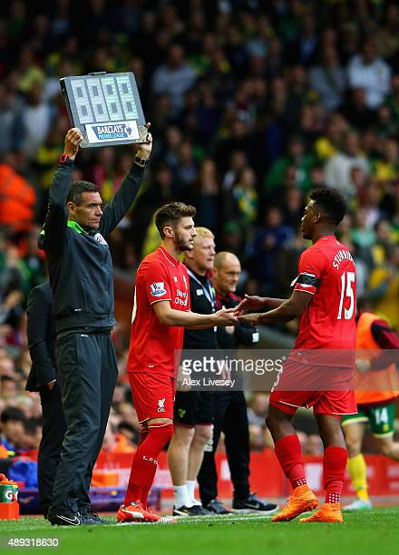 Daniel Sturridge of Liverpool is replaced by substitute Adam Lallana during the Barclays Premier League match between Liverpool and Norwich City at...