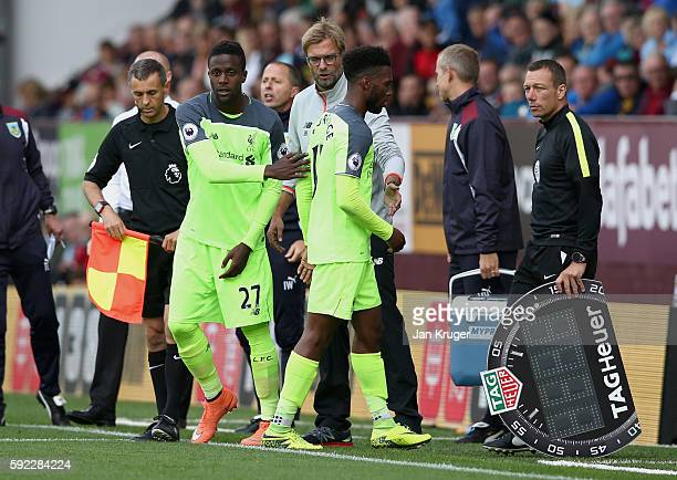 Daniel Sturridge of Liverpool is subbed off for Divock Origi of Liverpool during the Premier League match between Burnley and Liverpool at Turf Moor...