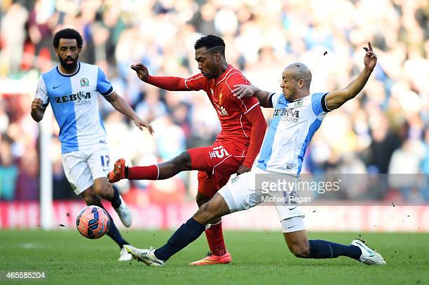 Daniel Sturridge of Liverpool is tackled by Alex Baptiste of Blackburn during the FA Cup Quarter Final match between Liverpool and Blackburn Rovers...