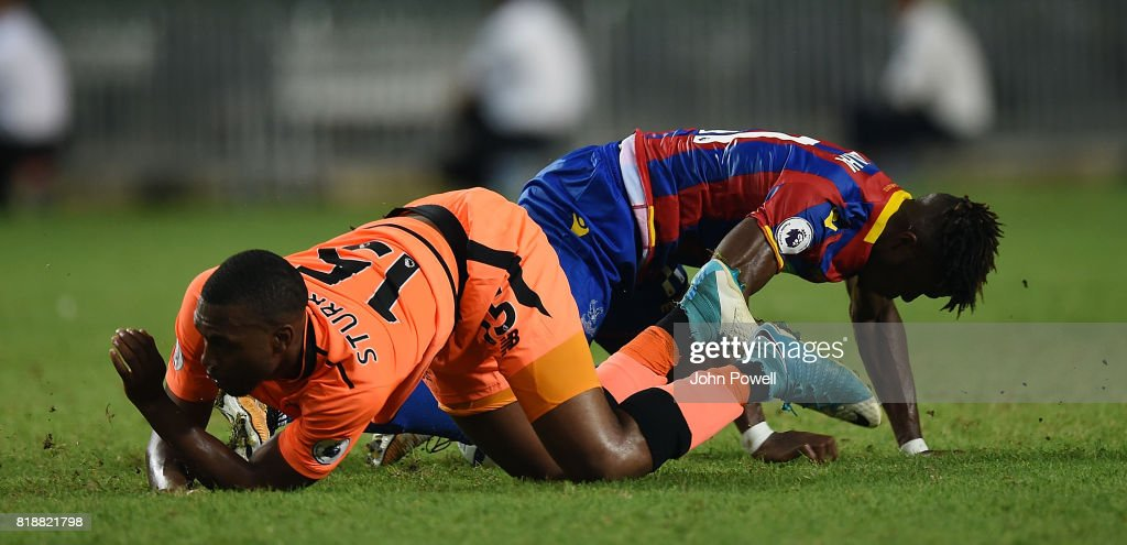 Daniel Sturridge of Liverpool on the floor with Wilfried Zaha of Crystal Palace during the Premier League Asia Trophy match between Liverpool FC and Crystal Palace on July 19, 2017 in Hong Kong Stadium, Hong Kong.