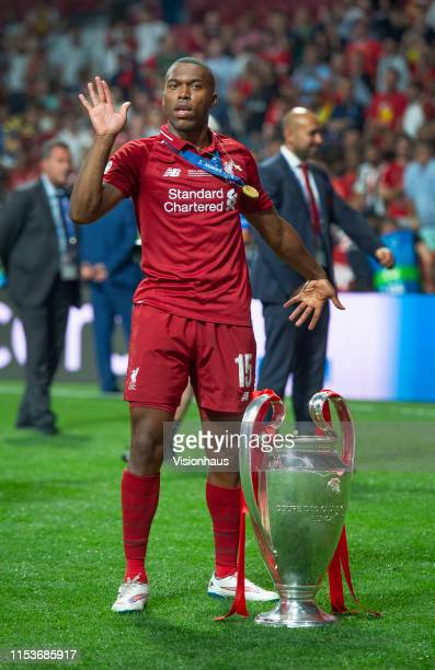 Daniel Sturridge of Liverpool performs his famous goal celebration dance with the trophy after winning the UEFA Champions League Final between...