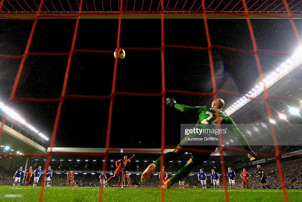 Daniel Sturridge of Liverpool puts his penalty attempt high over the crossbar of Tim Howard of Everton during the Barclays Premier League match between Liverpool and Everton at Anfield on January 28, 2014 in Liverpool, England.