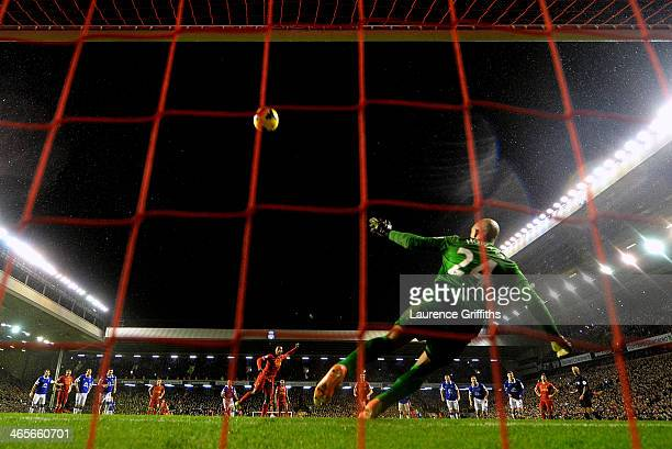Daniel Sturridge of Liverpool puts his penalty attempt high over the crossbar of Tim Howard of Everton during the Barclays Premier League match...