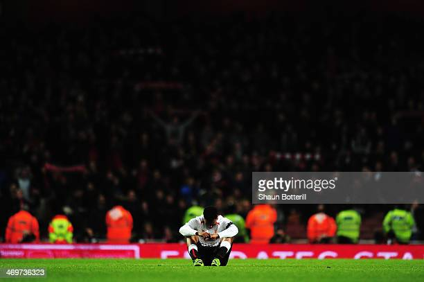 Daniel Sturridge of Liverpool reacts to defeat at the end of the FA Cup Fifth Round match between Arsenal and Liverpool at the Emirates Stadium on...