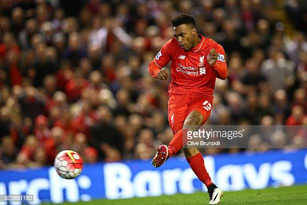Daniel Sturridge of Liverpool scores his sides third goal during the Barclays Premier League match between Liverpool and Everton at Anfield April 20...