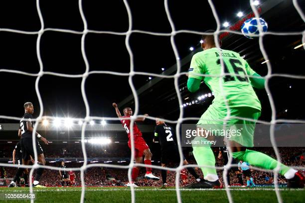 Daniel Sturridge of Liverpool scores his team's first goal past Alphonse Areola of Paris Saint-Germain during the Group C match of the UEFA Champions...