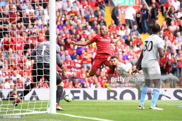 Daniel Sturridge of Liverpool scores his team's fourth goal during the Premier League match between Liverpool FC and West Ham United at Anfield on...