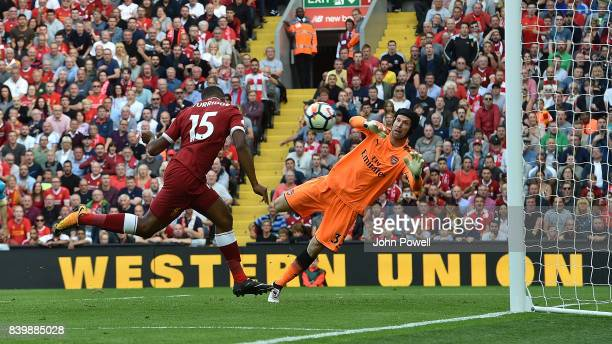 Daniel Sturridge of Liverpool scores his team's fourth goal during the Premier League match between Liverpool and Arsenal at Anfield on August 27...