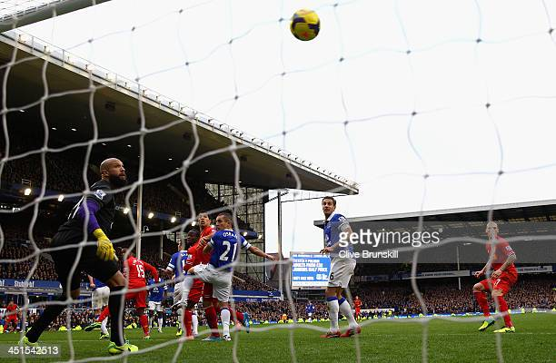 Daniel Sturridge of Liverpool scores his team's third goal during the Barclays Premier League match between Everton and Liverpool at Goodison Park on...
